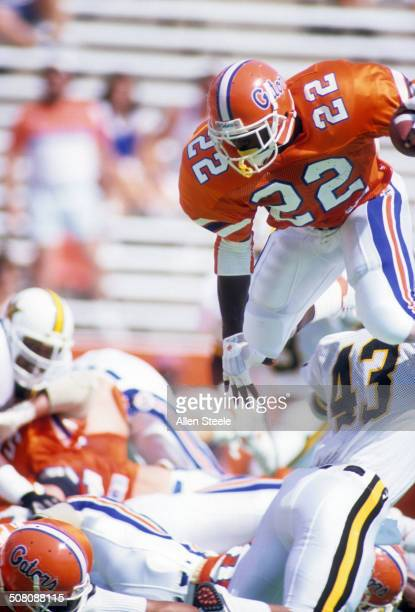 Running back Emmitt Smith of the Florida Gators jumps over the pile with the ball during a game against theVanderbilt Commodores at Ben Hill Griffin...