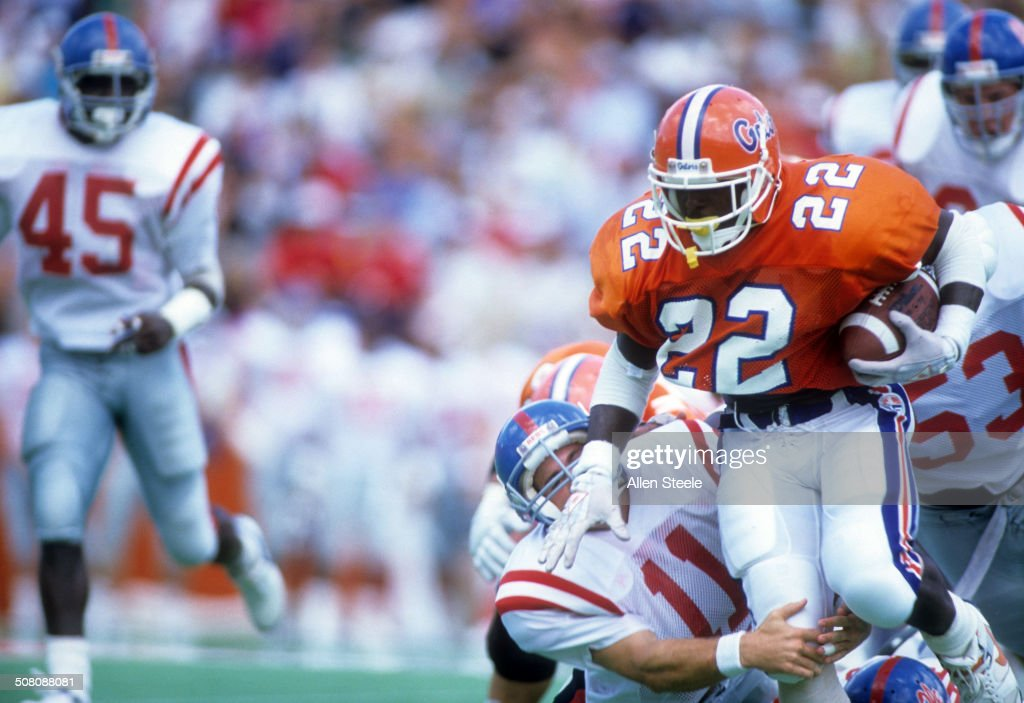 Running back Emmitt Smith of the Florida Gators runs with the ball during a game against the Ole Miss Rebels at Ben Hill Griffin Stadium on September...