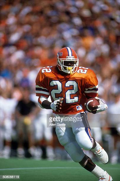 Running back Emmitt Smith of the Florida Gators runs with the ball during a game against theVanderbilt Commodores at Ben Hill Griffin Stadium on...