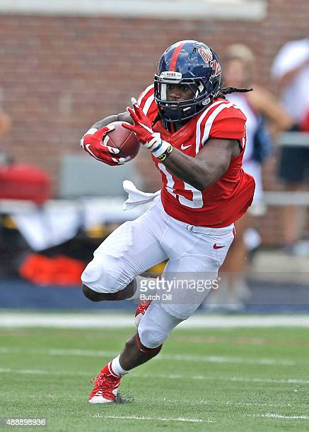 Running back Eugene Brazley of the Mississippi Rebels carries the ball for a touchdown during the second half of a NCAA college football game against...
