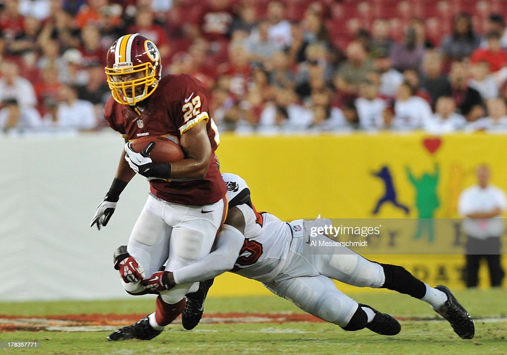 Running back <a gi-track='captionPersonalityLinkClicked' href=/galleries/search?phrase=Evan+Royster&family=editorial&specificpeople=4499934 ng-click='$event.stopPropagation()'>Evan Royster</a> #22 of the Washington Redskins runs for a 6-yard gain to midfield in the first quarter against the Tampa Bay Buccaneers August 29, 2013 at Raymond James Stadium in Tampa, Florida.