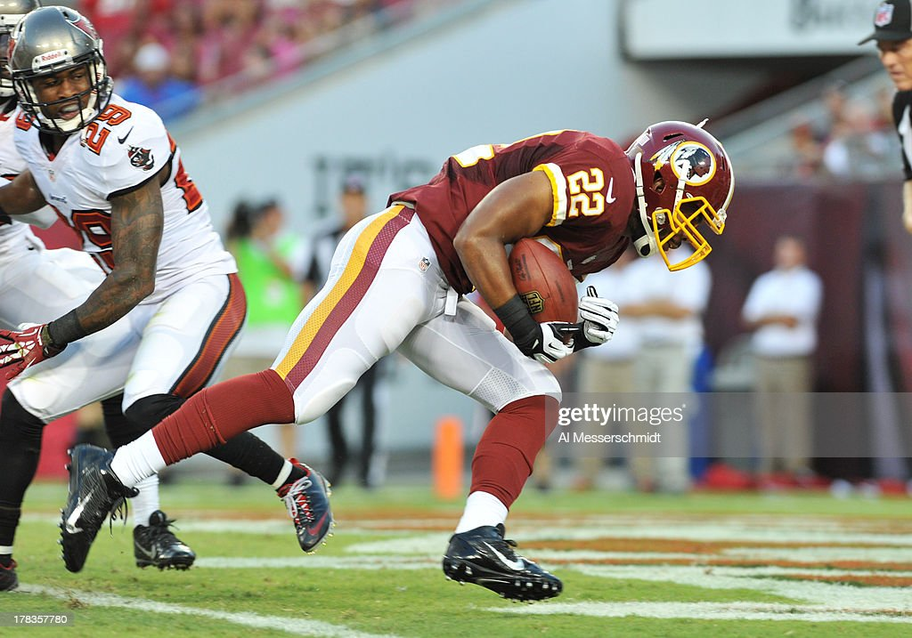 Running back <a gi-track='captionPersonalityLinkClicked' href=/galleries/search?phrase=Evan+Royster&family=editorial&specificpeople=4499934 ng-click='$event.stopPropagation()'>Evan Royster</a> #22 of the Washington Redskins runs for the opening touchdown in the first quarter against the Tampa Bay Buccaneers August 29, 2013 at Raymond James Stadium in Tampa, Florida.