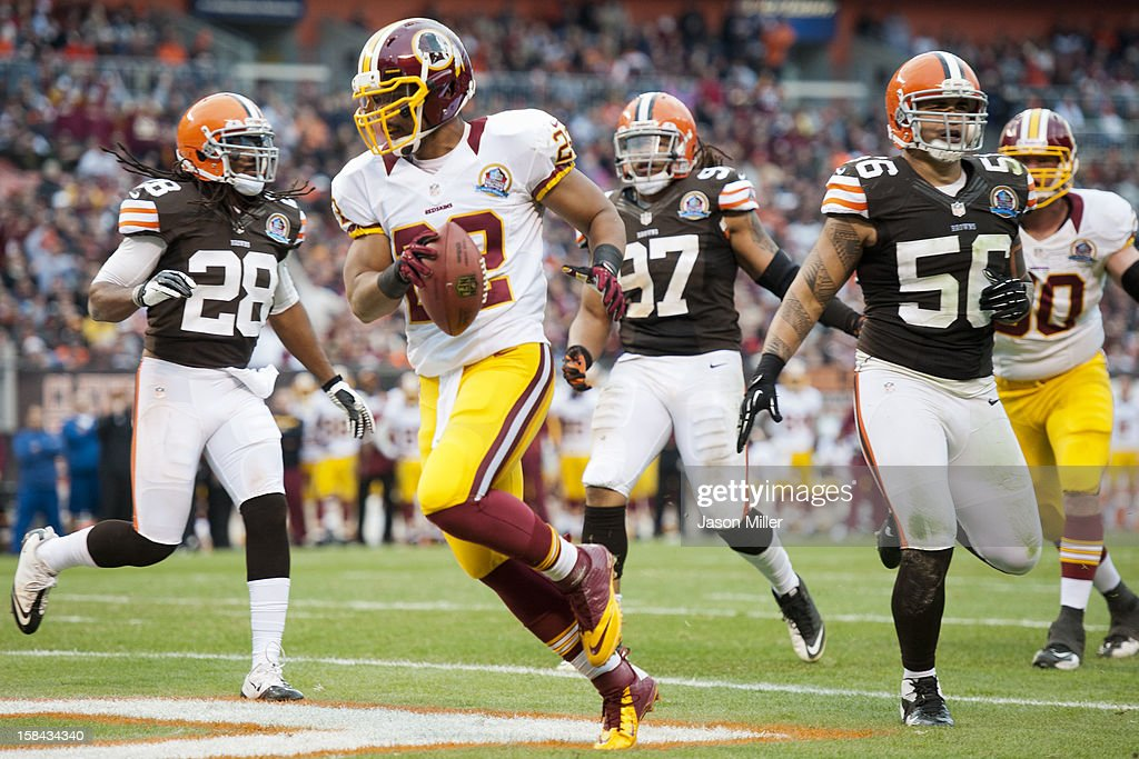 Running back <a gi-track='captionPersonalityLinkClicked' href=/galleries/search?phrase=Evan+Royster&family=editorial&specificpeople=4499934 ng-click='$event.stopPropagation()'>Evan Royster</a> #22 of the Washington Redskins runs in a touchdown during the second half against the Cleveland Browns at Cleveland Browns Stadium on December 16, 2012 in Cleveland, Ohio. The Redskins defeated the Browns 38-21.