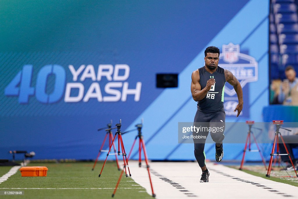 Running back Ezekiel Elliott of Ohio State runs the 40yard dash during the 2016 NFL Scouting Combine at Lucas Oil Stadium on February 26 2016 in...
