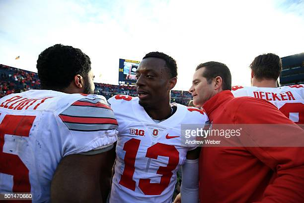 Running back Ezekiel Elliott of the Ohio State Buckeyes and cornerback Eli Apple of the Ohio State Buckeyes after the game against the Michigan...