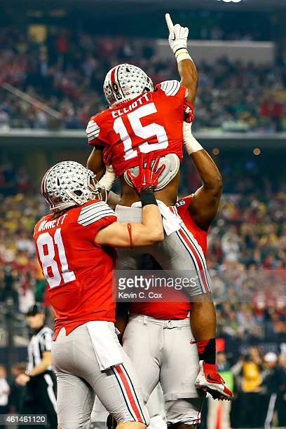Running back Ezekiel Elliott of the Ohio State Buckeyes celebrates after scoring a 33 yard touchdown in the first quarter against the Oregon Ducks...