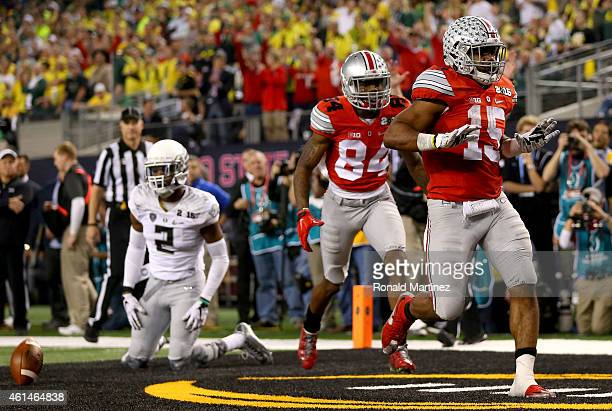 Running back Ezekiel Elliott of the Ohio State Buckeyes celebrates with wide receiver Corey Smith after Elliott scores a 9yard touchdown in the third...