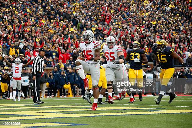 Running back Ezekiel Elliott of the Ohio State Buckeyes celebrates after rushing for a second quarter touchdown against the Michigan Wolverines at...
