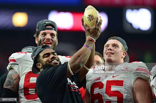 Running back Ezekiel Elliott of the Ohio State Buckeyes holds the Fiesta Bowl trophy after the BattleFrog Fiesta Bowl at University of Phoenix...