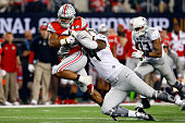 Running back Ezekiel Elliott of the Ohio State Buckeyes runs the ball in the second half against the Oregon Ducks during the College Football Playoff...