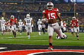 Running back Ezekiel Elliott of the Ohio State Buckeyes scores a 33 yard touchdown in the first quarter against the Oregon Ducks during the College...