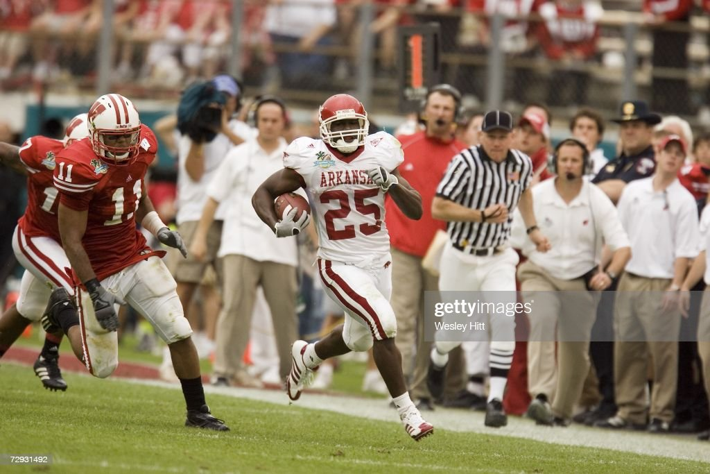 Running back Felix Jones of the Arkansas Razorbacks runs for a touchdown against the Wisconsin Badgers in the Capital One Bowl at the Florida Citrus...