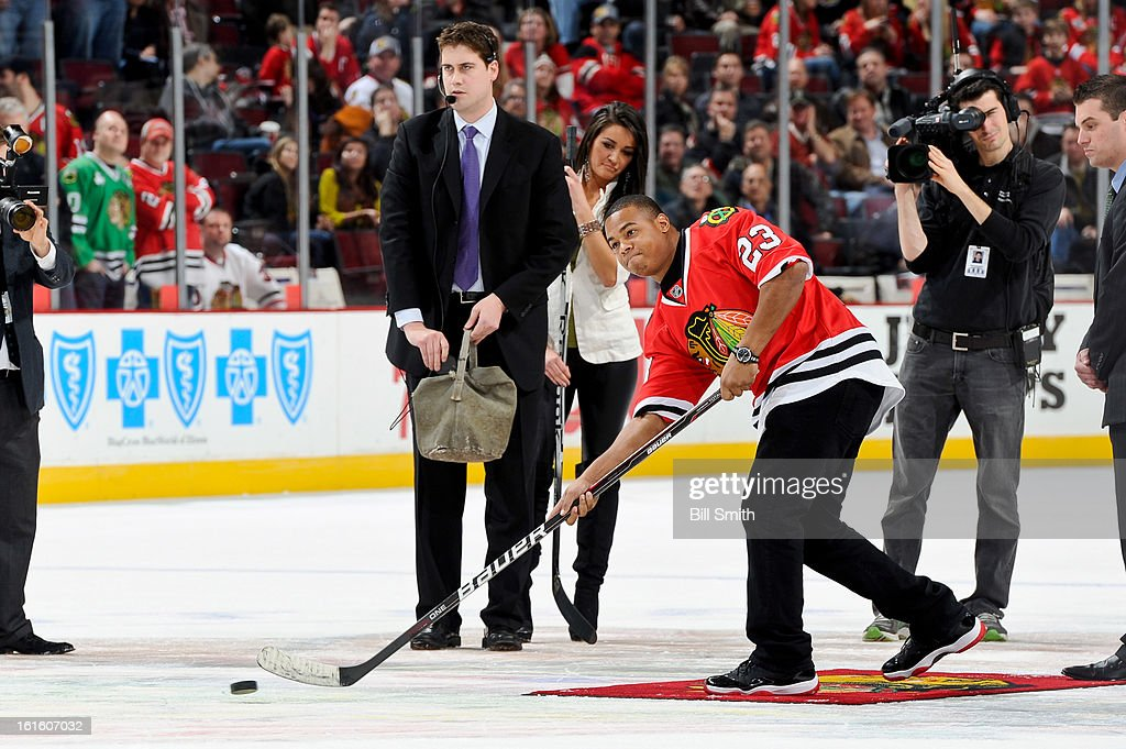 NFL running back for the New Orleans Saints, Pierre Thomas, shoots the puck for charity in between periods of the NHL game between the Anaheim Ducks and the Chicago Blackhawks on February 12, 2013 at the United Center in Chicago, Illinois.