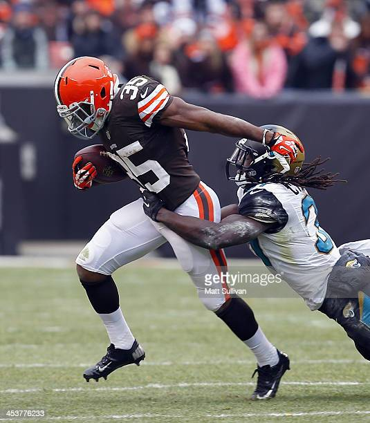 Running back Fozzy Whittaker of the Cleveland Browns runs by safety Johnathan Cyprien of the Jacksonville Jaguars at FirstEnergy Stadium on December...