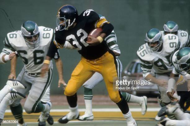 Running back Franco Harris of the Pittsburgh Steelers carries the ball against the Philadelphia Eagles November 3 1974 during an NFL football game at...