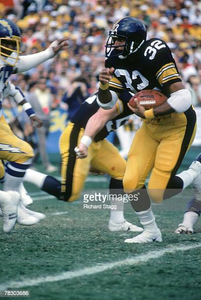 Running back Franco Harris of the Pittsburgh Steelers runs upfield against the San Diego Chargers at Jack Murphy Stadium on November 18 1979 in San...
