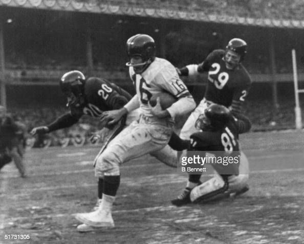 Running back Frank Gifford of the New York Giants scores a touch down after receiving a pass during the Championship game against the Chicago Bears...