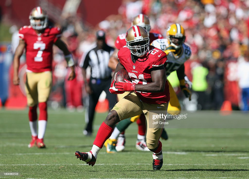 Running back <a gi-track='captionPersonalityLinkClicked' href=/galleries/search?phrase=Frank+Gore&family=editorial&specificpeople=233698 ng-click='$event.stopPropagation()'>Frank Gore</a> #21 of the San Francisco 49ers carries the ball against the Green Bay Packers in the fourth quarter at Candlestick Park on September 8, 2013 in San Francisco, California. The 49ers defeated the Packers 34-28.