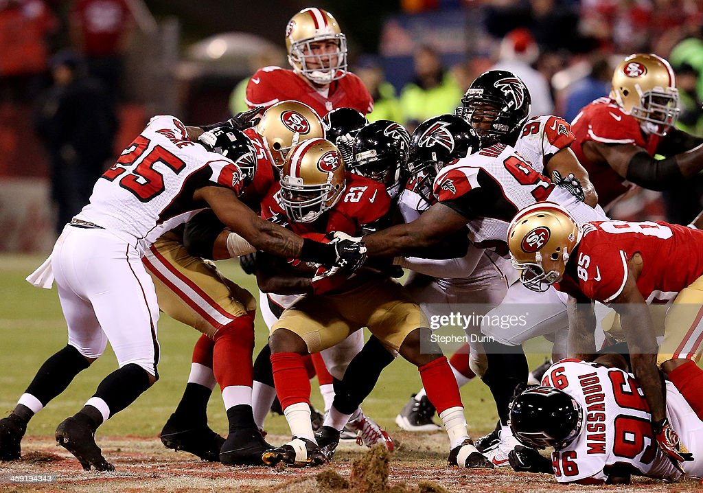 Running back <a gi-track='captionPersonalityLinkClicked' href=/galleries/search?phrase=Frank+Gore&family=editorial&specificpeople=233698 ng-click='$event.stopPropagation()'>Frank Gore</a> #21 of the San Francisco 49ers carries the ball against the Atlanta Falcons during a game at Candlestick Park on December 23, 2013 in San Francisco, California.