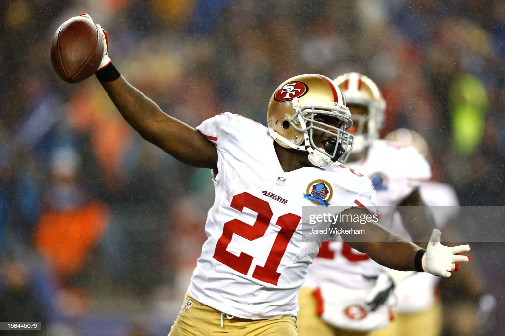 Running back <a gi-track='captionPersonalityLinkClicked' href=/galleries/search?phrase=Frank+Gore&family=editorial&specificpeople=233698 ng-click='$event.stopPropagation()'>Frank Gore</a> #21 of the San Francisco 49ers celebrates after scoring a touchdown in the third quarter against the New England Patriots at Gillette Stadium on December 16, 2012 in Foxboro, Massachusetts.