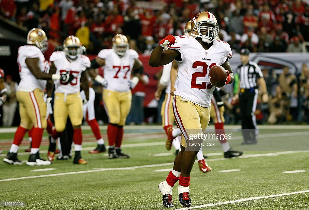Running back <a gi-track='captionPersonalityLinkClicked' href=/galleries/search?phrase=Frank+Gore&family=editorial&specificpeople=233698 ng-click='$event.stopPropagation()'>Frank Gore</a> #21 of the San Francisco 49ers celebrates after scoring a nine-yard touchdown in the fourth quarter against the Atlanta Falcons in the NFC Championship game at the Georgia Dome on January 20, 2013 in Atlanta, Georgia.
