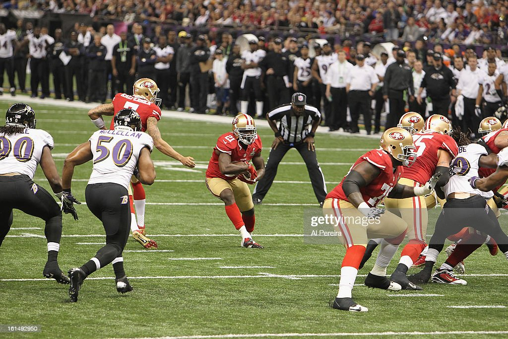 Running Back Frank Gore #21 of the San Francisco 49ers has a long gain against the Baltimore Ravens during Super Bowl XLVII at Mercedes-Benz Superdome on February 3, 2013 in New Orleans, Louisiana.