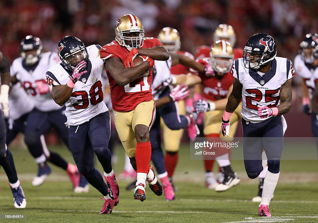 Running back <a gi-track='captionPersonalityLinkClicked' href=/galleries/search?phrase=Frank+Gore&family=editorial&specificpeople=233698 ng-click='$event.stopPropagation()'>Frank Gore</a> #21 of the San Francisco 49ers is pursued by <a gi-track='captionPersonalityLinkClicked' href=/galleries/search?phrase=Danieal+Manning+-+American+Football+Player&family=editorial&specificpeople=589817 ng-click='$event.stopPropagation()'>Danieal Manning</a> (L) #38 and <a gi-track='captionPersonalityLinkClicked' href=/galleries/search?phrase=Kareem+Jackson&family=editorial&specificpeople=3908085 ng-click='$event.stopPropagation()'>Kareem Jackson</a> #25 of the Houston Texans in the second half at Candlestick Park on October 6, 2013 in San Francisco, California. The 49ers defeated the Texans 34-3.