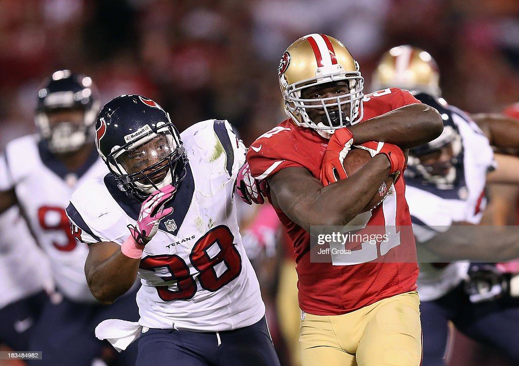 Running back <a gi-track='captionPersonalityLinkClicked' href=/galleries/search?phrase=Frank+Gore&family=editorial&specificpeople=233698 ng-click='$event.stopPropagation()'>Frank Gore</a> #21 of the San Francisco 49ers is pursued by strong safety <a gi-track='captionPersonalityLinkClicked' href=/galleries/search?phrase=Danieal+Manning+-+American+Football+Player&family=editorial&specificpeople=589817 ng-click='$event.stopPropagation()'>Danieal Manning</a> #38 of the Houston Texans in the second half at Candlestick Park on October 6, 2013 in San Francisco, California. The 49ers defeated the Texans 34-3.