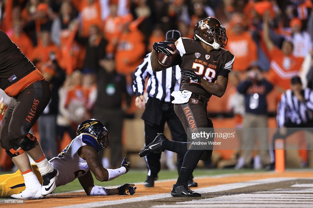 Running back Fred Coppet #28 of the Bowling Green Falcons rushes into the end zone for a touchdown during the second quarter against the Toledo Rockets at Doyt Perry Stadium on November 17, 2015 in Bowling Green, Ohio.