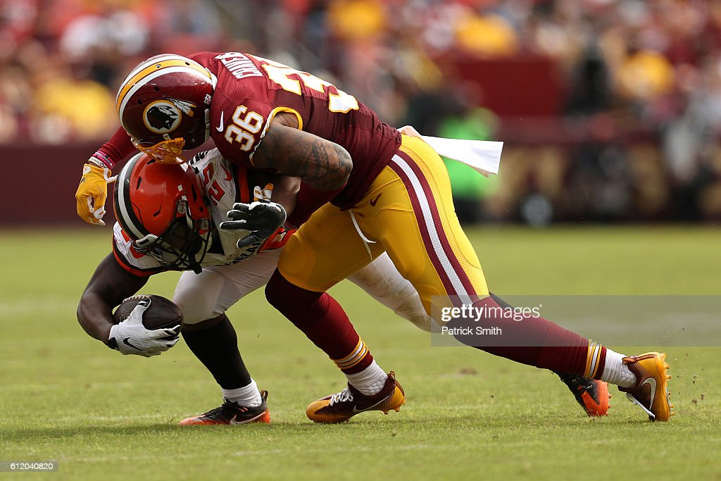 Running back George Atkinson #25 of the Cleveland Browns is tackled by defensive back Su'a Cravens #36 of the Washington Redskins in the second quarter at FedExField on October 2, 2016 in Landover, Maryland.