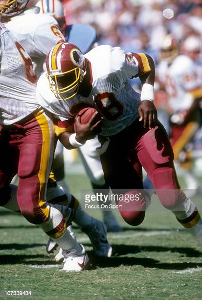 Running back George Rogers of the Washington Redskins carries the ball against the Houston Oilers during an NFL football game at RFK Stadium...
