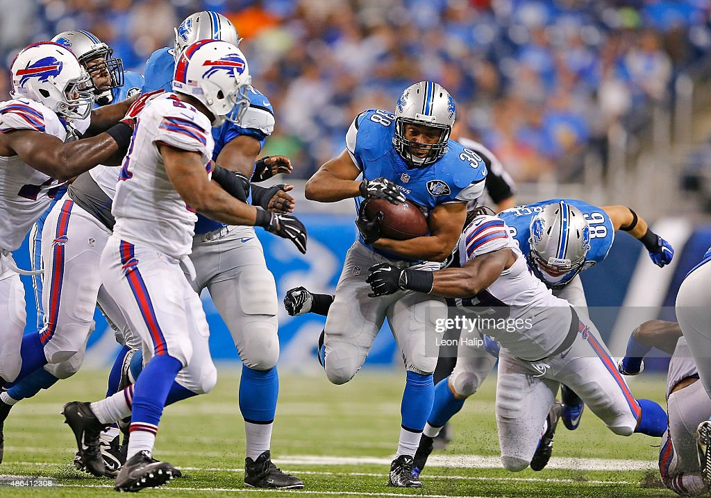 running back George Winn #38 of the Detroit Lions runs for a first down during the fourth quarter of the preseason game against the Buffalo Bills on September 3, 2015 at Ford Field Detroit, Michigan. The Lions defeated the Bills 17-10.