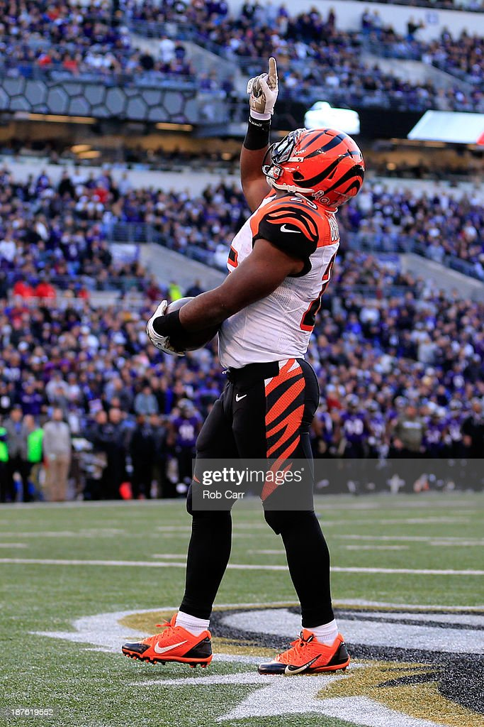 Running back Gio Bernard #25 of the Cincinnati Bengals celebrates after catching a touchdown pass against the Baltimore Ravens during the second half of the Ravens 20-17 overtime win at M&T Bank Stadium on November 10, 2013 in Baltimore, Maryland.