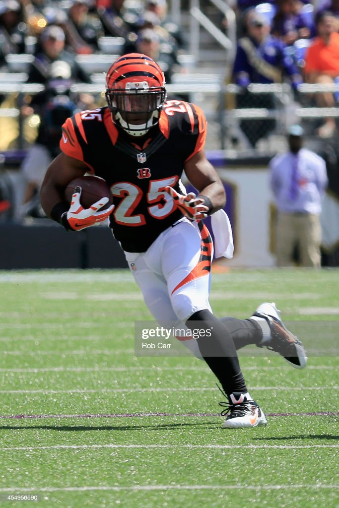 Running back Giovani Bernard of the Cincinnati Bengals carries the ball against the Baltimore Ravens at MT Bank Stadium on September 7 2014 in...