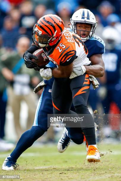 Running Back Giovani Bernard of the Cincinnati Bengals carries the ball against Linebacker Jayon Brown of the Tennessee Titans at Nissan Stadium on...