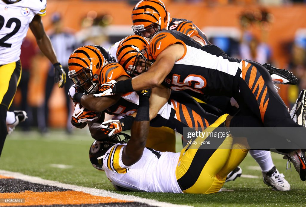Running back <a gi-track='captionPersonalityLinkClicked' href=/galleries/search?phrase=Giovani+Bernard&family=editorial&specificpeople=8162745 ng-click='$event.stopPropagation()'>Giovani Bernard</a> #25 of the Cincinnati Bengals dives into the endzone for a seven-yard touchdown run in the first quarter against the Pittsburgh Steelers in the first half at Paul Brown Stadium on September 16, 2013 in Cincinnati, Ohio.