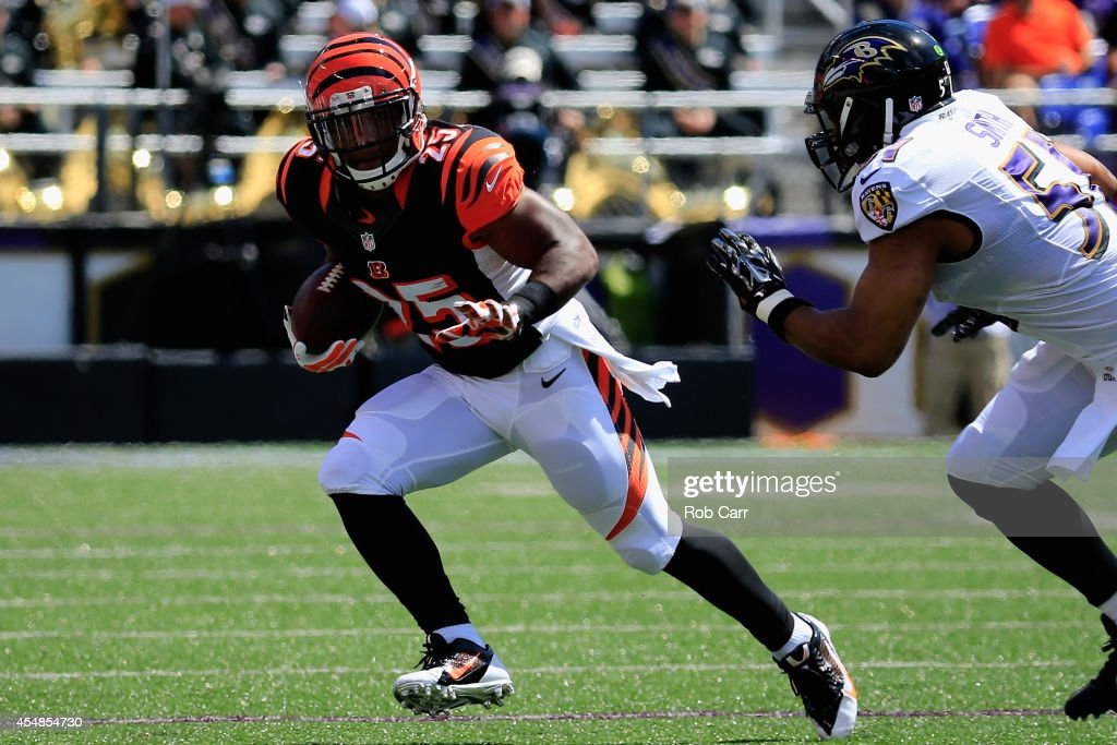 Running back Giovani Bernard of the Cincinnati Bengals looks to shed a defender during an NFL football game against the Baltimore Ravens at MT Bank...