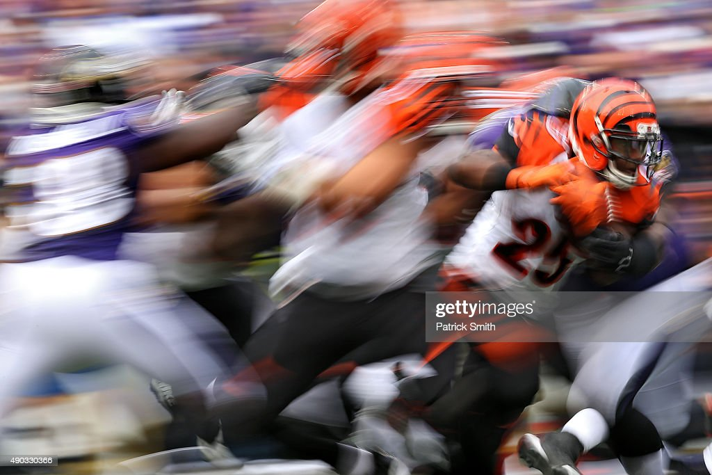 Running back <a gi-track='captionPersonalityLinkClicked' href=/galleries/search?phrase=Giovani+Bernard&family=editorial&specificpeople=8162745 ng-click='$event.stopPropagation()'>Giovani Bernard</a> #25 of the Cincinnati Bengals rushes against the Baltimore Ravens in the second half at M&T Bank Stadium on September 27, 2015 in Baltimore, Maryland.