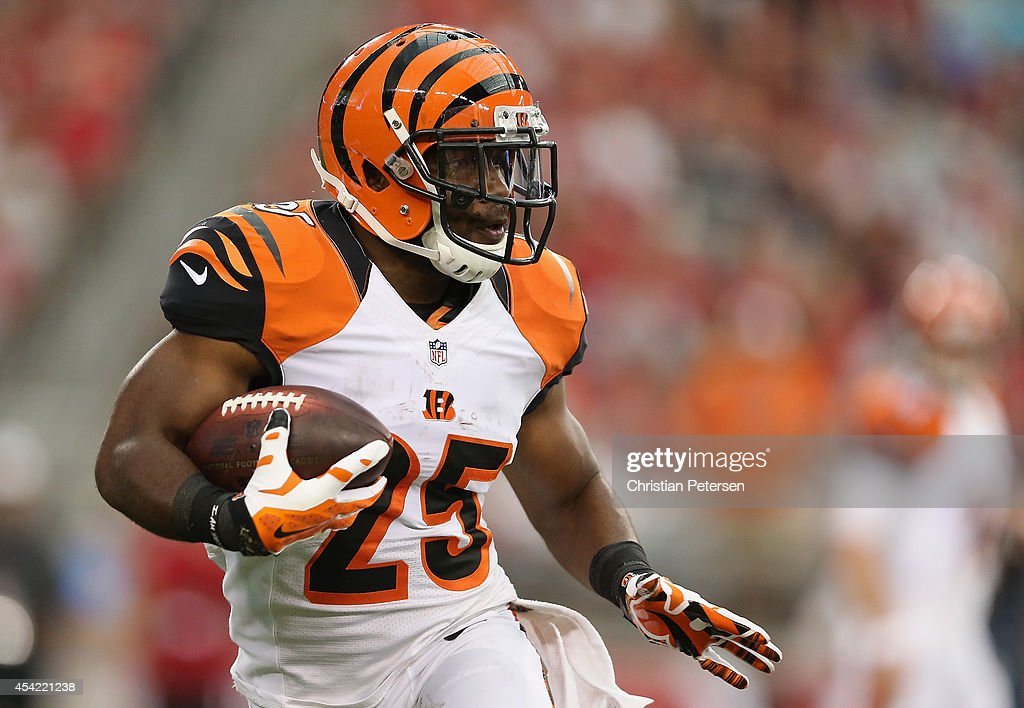 Running back Giovani Bernard of the Cincinnati Bengals rushes the football against the Arizona Cardinals during the preseason NFL game at the...