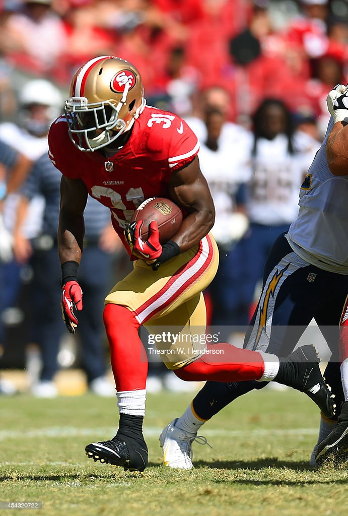 Running back Glenn Winston #31 of the San Francisco 49ers runs for a touchdown against the San Diego Chargers during the fourth quarter of the preseason game at Levi's Stadium on August 24, 2014 in Santa Clara, California.