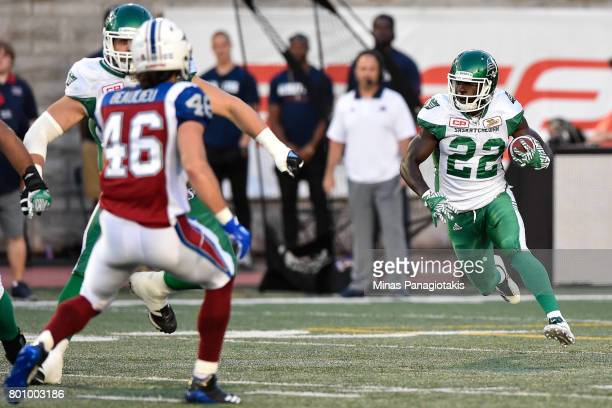 Running back Greg Morris of the Saskatchewan Roughriders runs with the ball against the Montreal Alouettes during the CFL game at Percival Molson...