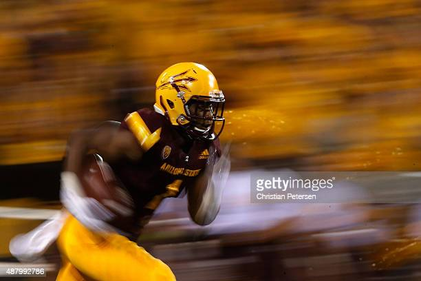 Running back Gump Hayes of the Arizona State Sun Devils returns a kick off during the second quarter of the college football game against the Cal...