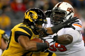 Running back Henry Josey of the Missouri Tigers runs against Calvin Barnett of the Oklahoma State Cowboys in the first half during the ATT Cotton...