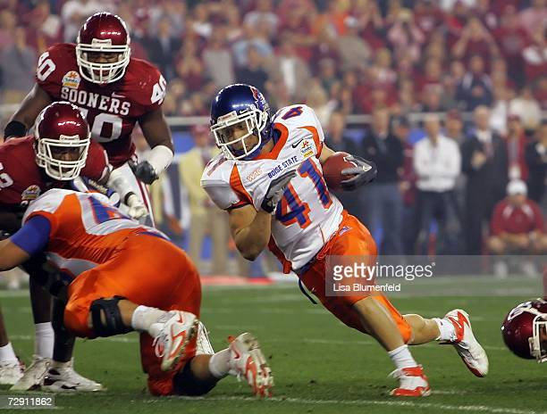 Running back Ian Johnson of the Boise State Broncos runs the football in the first quarter against the Oklahoma Sooners at the Tostito's Fiesta Bowl...