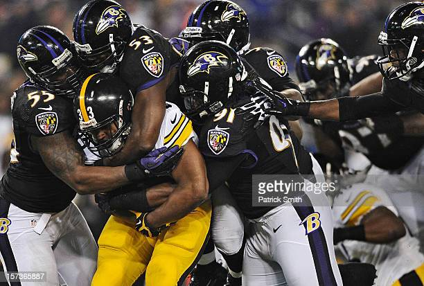 Running back Isaac Redman of the Pittsburgh Steelers is pulled down by a pack of Baltimore Ravens defenders in the third quarter at MT Bank Stadium...