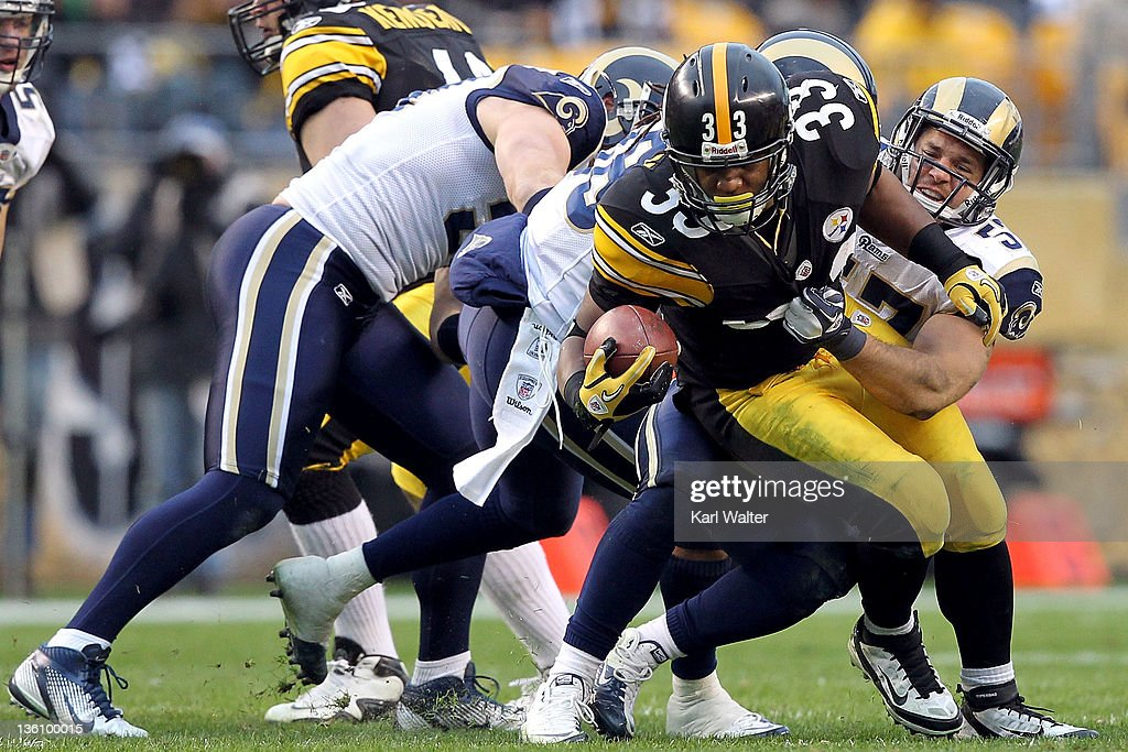Running back Isaac Redman #33 of the Pittsburgh Steelers is tackled by lineback Chris Chamberlain #57 of the St. Louis Rams during their game at Heinz Field on December 24, 2011 in Pittsburgh, Pennsylvania.