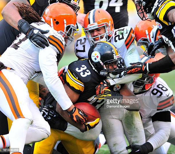PITTSBURGH PENNSYLVANIA DECEMBER 30 2012 Running back Isaac Redman of the Pittsburgh Steelers is tackled by defensive back Eric Hagg and defensive...