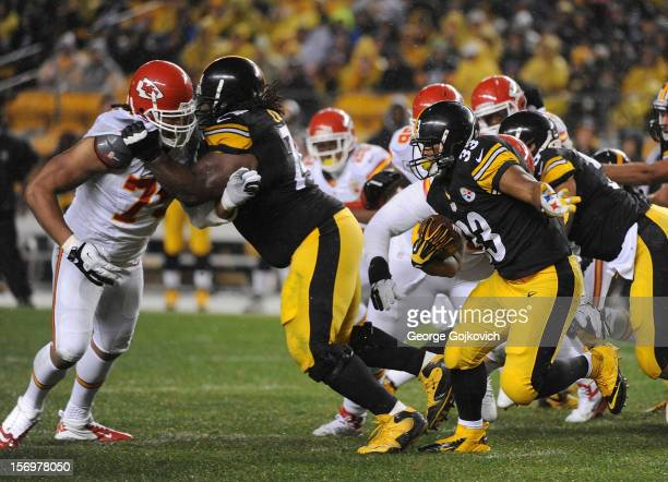 Running back Isaac Redman of the Pittsburgh Steelers runs with the football as offensive guard Willie Colon blocks defensive end Ropati Pitoitua of...