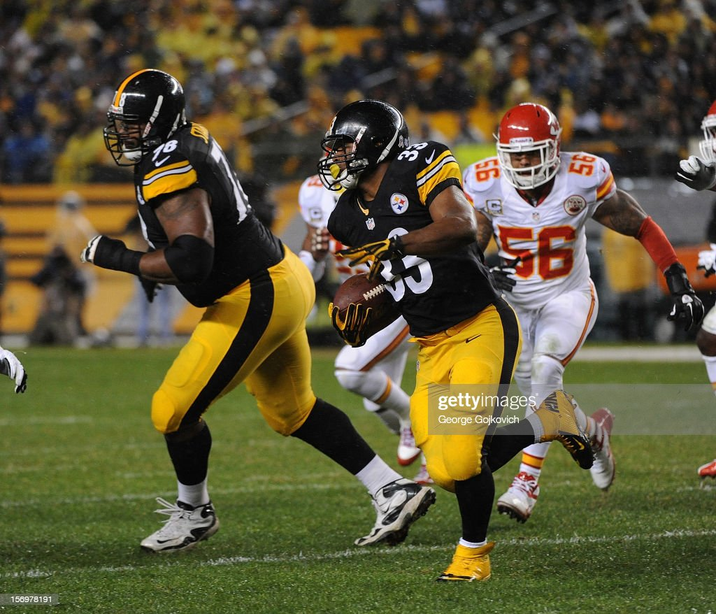 Running back Isaac Redman #33 of the Pittsburgh Steelers runs with the football as offensive tackle Max Starks #78 blocks and linebacker Derrick Johnson #56 of the Kansas City Chiefs pursues the play at Heinz Field on November 12, 2012 in Pittsburgh, Pennsylvania. The Steelers defeated the Chiefs 16-13.