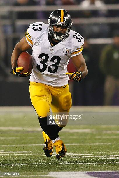 Running back Isaac Redman of the Pittsburgh Steelers rushes the ball against the Baltimore Ravens at MT Bank Stadium on December 2 2012 in Baltimore...